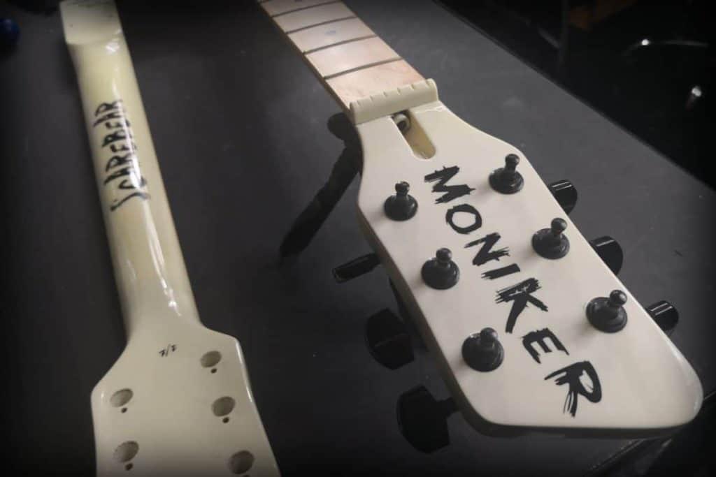 Moniker Guitars headstock