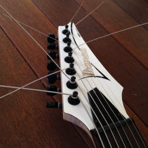 Stringjoy strings in an Ibanez headstock