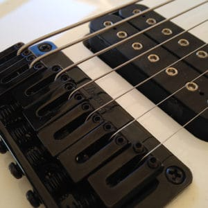 Stringjoy strings in an Ibanez bridge